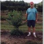 Man standing next to tree